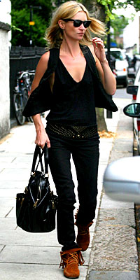 In her go-to uniform: skinny jeans, Minnetonkas, black, and a too-cool attitude.
