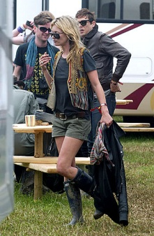 Glastonbury in the requisite wellies and totally authentic ensemble.