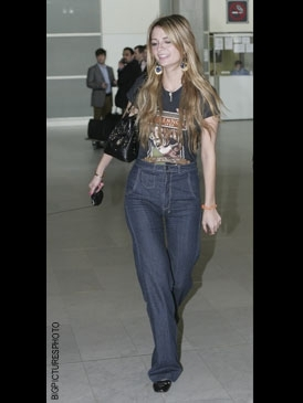 With high waisted jeans for a '70s vibe