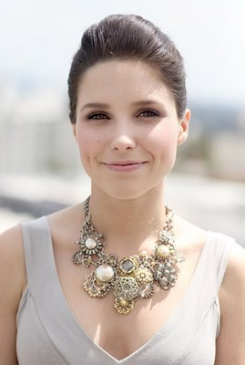 Sophia Bush looks regal in a chignon and big floral necklace.