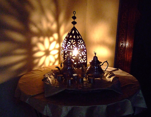 Moroccan lanterns cast such beautiful shapes onto the wall.