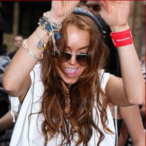 Lindsay parties with wrists full of bracelets