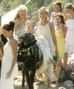 Amanda Seyfried in wedding dress in Mamma Mia on donkey