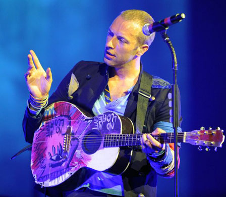 Chris Martin with one of his amazing designed guitars