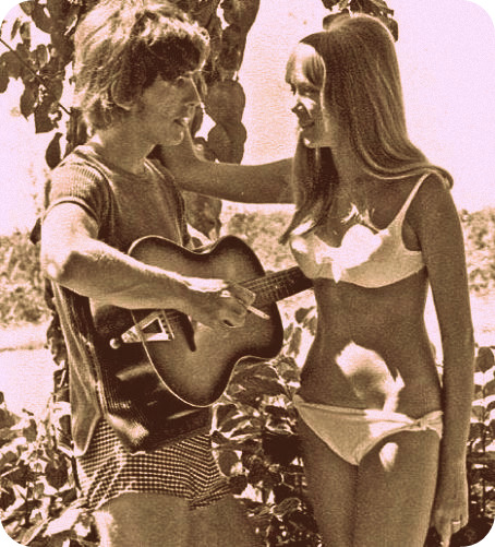 How cute: Pattie Boyd and George Harrison with his guitar.