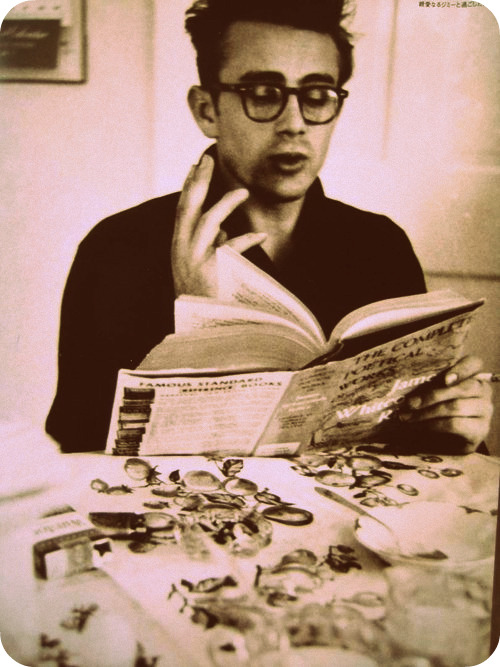 James Dean readings and smoking wearing glasses