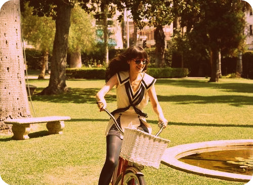 @KaileyPenis Zooey-deschanel-bike